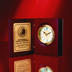 Rosewood Book ClockHinged  Award in presentation Book Form. This Book Clock has Hand-rubbed  Rosewood finish and a brass engraving plate ideal for adding logos and  personalization.Call 800-830-3386 to buy now!